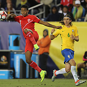 FOXBOROUGH, MASSACHUSETTS - JUNE 12: Andy Polo #8 of Peru clears the ball as Filipe Luis #6 of Brazil looks on during the Brazil Vs Peru Group B match of the Copa America Centenario USA 2016 Tournament at Gillette Stadium on June 12, 2016 in Foxborough, Massachusetts. (Photo by Tim Clayton/Corbis via Getty Images)