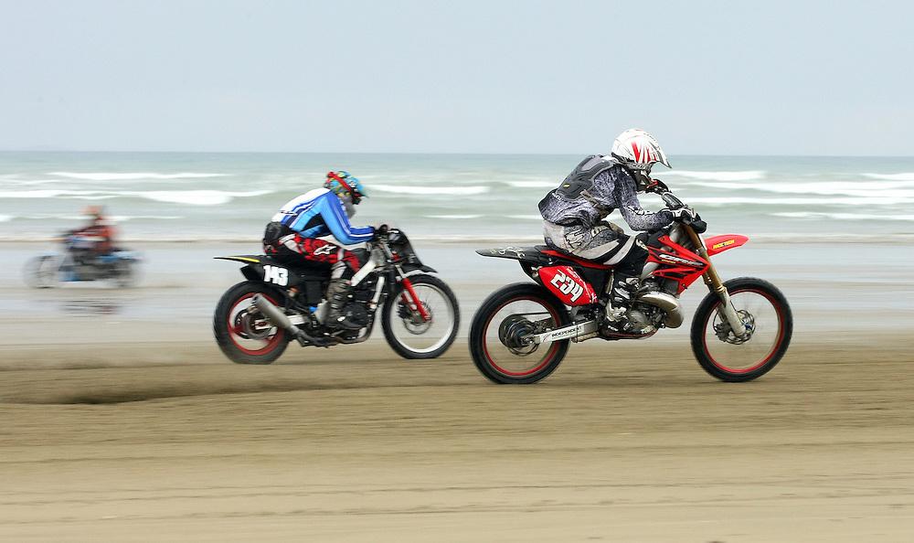Timaru's James O'Connor, right, rides ahead of Invercargill's Jason Nicol at the 2012 New Zealand Beach Racing Championships, Burt Munro Challenge, Oreti Beach, Invercargill, New Zealand, Friday, November 22, 2012. Credit:SNPA / Dianne Manson.