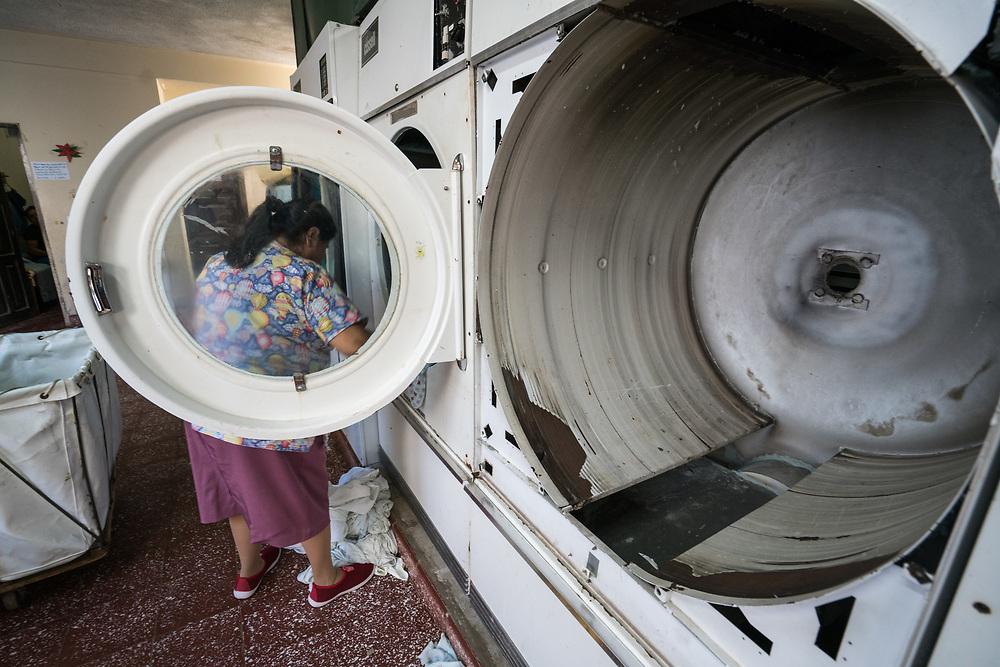 A woman works in the laundry facility at Occidente Hospital in Santa Rosa de Copan, Copan, Honduras on Feb. 8, 2017. Photo Ken Cedeno