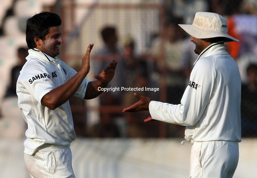 Indian bowler Suresh Raina celebrates with Harbhajan Singh New Zealand batsman Jesse Ryder wicket during the 2nd test match Indian vs New Zealand day-4 Played at Rajiv Gandhi International Stadium, Uppal, Hyderabad, 15 November 2010 (5-day match)