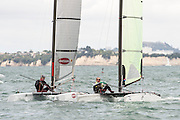 Chris Nicholson (AUS1003) and Luc du Bois (SUI10), race one of the A Class World championships regatta being sailed at Takapuna in Auckland. 11/2/2014
