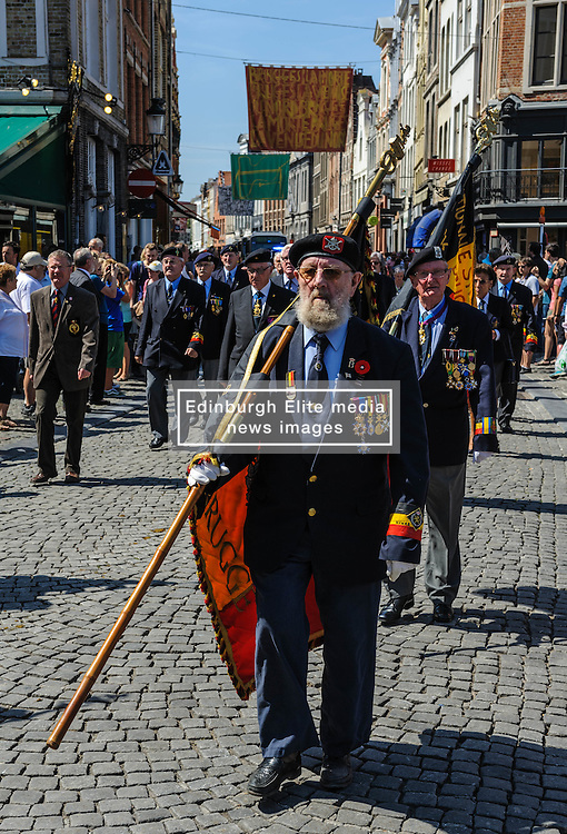World War 2 veterans march behind a band in the Grote Markt, Bruges, Belgium as part of the celebrations of Belgium's National Day on 22nd July.<br /> <br /> (c) Andrew Wilson | Edinburgh Elite media