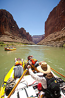 Young men taking a nap while rafting the Grand Canyon. Grand Canyon National Park, AZ.