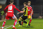 Chesterfield FC defender Liam O'Neil flicks the ball past Burton Albion forward Mason Bennett during the Sky Bet League 1 match between Burton Albion and Chesterfield at the Pirelli Stadium, Burton upon Trent, England on 12 February 2016. Photo by Aaron Lupton.