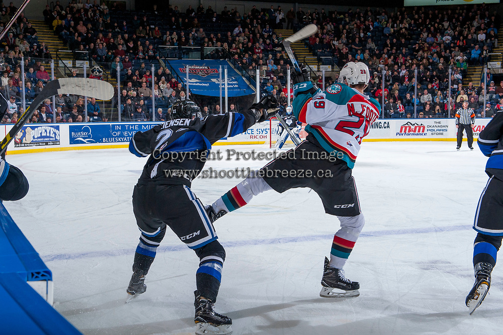 KELOWNA, CANADA - DECEMBER 30: Kade Jensen #21 of the Victoria Royals checks Nolan Foote #29 of the Kelowna Rockets as he shoots the puck over the blue line during first period on December 30, 2017 at Prospera Place in Kelowna, British Columbia, Canada.  (Photo by Marissa Baecker/Shoot the Breeze)  *** Local Caption ***