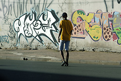 JOHANNESBURG, SOUTH AFRICA - MAY 10: A walker out exercising in Maboneng during lockdown level 4 on May 10, 2020 in Johannesburg, South Africa. According to media reports, during lockdown level 4 people are allowed to exercise. Guidelines allow for cycling, running and walking as examples and must be within a 5km radius of their residences between 6:00 am – 9:00 am. (Photo by Dino Lloyd)