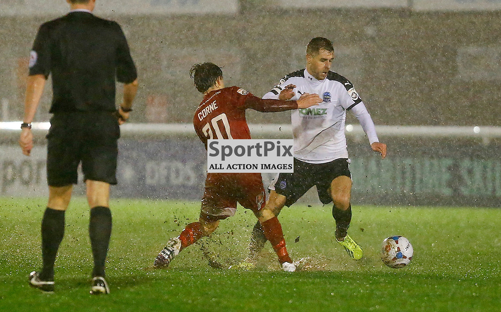 Dover's midfielder Nick Deverdics (17) beats Welling's Sam Corne (20) as the conditions worsen. The weather forced the game between Dover Athletic v Welling United to be abandoned shortly into the second half. Vanarama National League. 02  January 2016. (c) Matt Bristow | SportPix.org.uk
