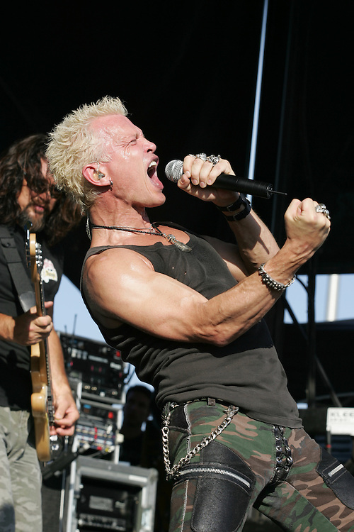 Billy Idol and his lead guitarist Steve Stevens rock the crowd at the warped tour as it makes it's annual stop at the Utah State Fair Park in Salt Lake City, Utah Saturday July 16, 2005.  August Miller/ Deseret Morning News