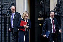 © Licensed to London News Pictures. 05/03/2019. London, UK. Transport Secretary Chris Grayling (L), Secretary of State for Work and Pensions Amber Rudd (C) and Justice Secretary David Gauke (R) leave 10 Downing Street after the Cabinet meeting. Photo credit: Rob Pinney/LNP