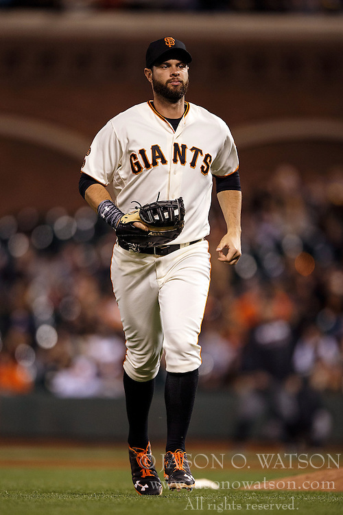 SAN FRANCISCO, CA - APRIL 18: Brandon Belt #9 of the San Francisco Giants returns to the dugout against the Arizona Diamondbacks during the eighth inning at AT&T Park on April 18, 2016 in San Francisco, California. The Arizona Diamondbacks defeated the San Francisco Giants 9-7 in 11 innings.  (Photo by Jason O. Watson/Getty Images) *** Local Caption *** Brandon Belt