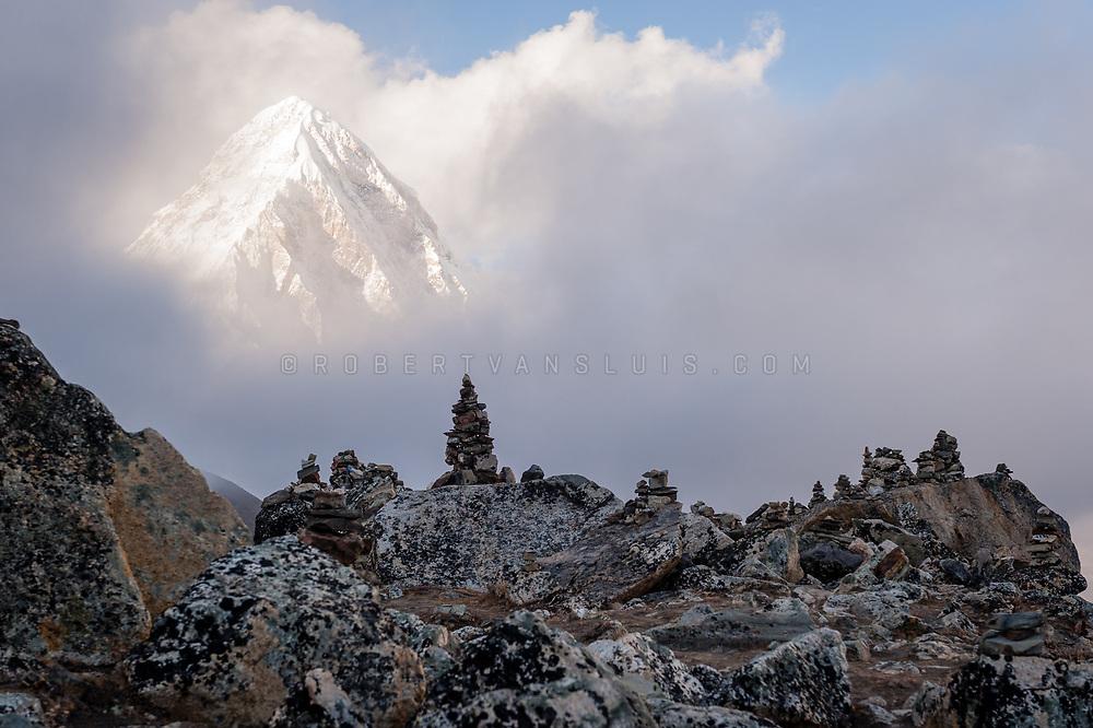 Pumori (7161 m) with cairns in the foreground, Nepal Himalaya. Photo © robertvansluis.com