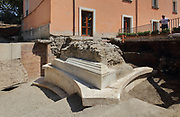 Monumental marble tomb, 69 AD, with a long epigraph inscribed on the side, at the Porta Stabia or Stabian Gate, discovered 2017, in the Parco Archeologico di Pompei, or Archaeological Park of Pompeii, Campania, Italy. The tomb is that of a magistrate who is thought to have died during a fight at a gladiator contest. The detailed 4m long epigraph describes his life, achievements and death. The site was excavated as part of the Great Pompeii Project in the San Paolino area near Porta Stabia, one of the access points to the ancient city. A new phase of official excavations has been taking place here since 2017 in an attempt to stop looters from digging tunnels and removing artefacts for sale. Pompeii was a Roman city which was buried in ash after the eruption of Vesuvius in 79 AD. The site is listed as a UNESCO World Heritage Site. Picture by Manuel Cohen