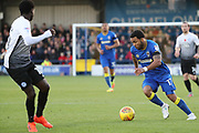 AFC Wimbledon striker Andy Barcham (17) dribbling during the EFL Sky Bet League 1 match between AFC Wimbledon and Peterborough United at the Cherry Red Records Stadium, Kingston, England on 12 November 2017. Photo by Matthew Redman.