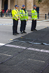 © Licensed to London News Pictures. 10/09/2017. London, UK.  Hostile Vehicle Mitigation Equipment, referred to internally by the Met Police as Talon, in use for the first time in Whitehall this morning (Sunday). The wide mats contain a double row of barbed spikes that disable any vehicle driving over them by wrapping the netting around the front wheels. This differs from stingers or stop sticks which merely deflate the tyres allowing the vehicle to continue.   Photo credit: Cliff Hide/LNP