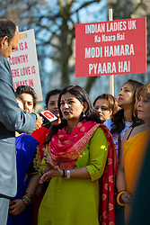 © Licensed to London News Pictures. 18/04/2018. London, UK. Supporters of Indian Prime Minister Narendra Modi gather opposite Downing Street as Modi arrives to meet with Prime Minister Theresa May. Photo credit: Rob Pinney/LNP