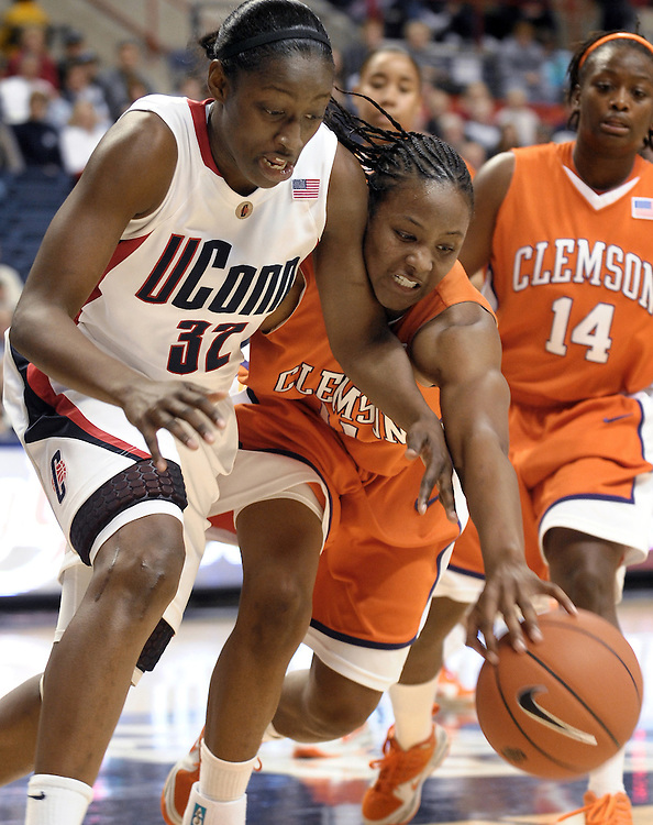 Connecticut's Kalana Greene, left, and Clemson's Lele Hardy, right, try to gain possession of the ball in the second half of an NCAA college basketball game in Storrs, Conn., Sunday, Nov. 29, 2009.  Greene and Hardy were top scorers for their teams, Greene with 28 and Hardy with 17. Connecticut won 87-48. (AP Photo/Jessica Hill)