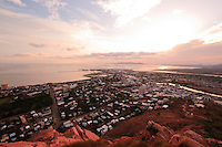 The sun rises over the far north Queensland city of Townsville, as seen from the summit of Castle Hill.