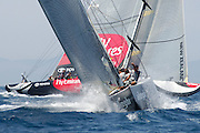 Alinghi, SUI75 approaches the top mark as Emirates Team New Zealand, NZL82 arrives at the port layline. Delta at the mark was 31 seconds. Louis Vuitton Act 4. Valencia, Spain. 21/6/2005