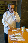 Ferran Adrià, chef of El Bulli restaurant near Rosas on the Costa Brava in Northern Spain taste tests food samples in the restaurant's kitchen. (Ferran Adrià is featured in the book What I Eat: Around the World in 80 Diets.) MODEL RELEASED.