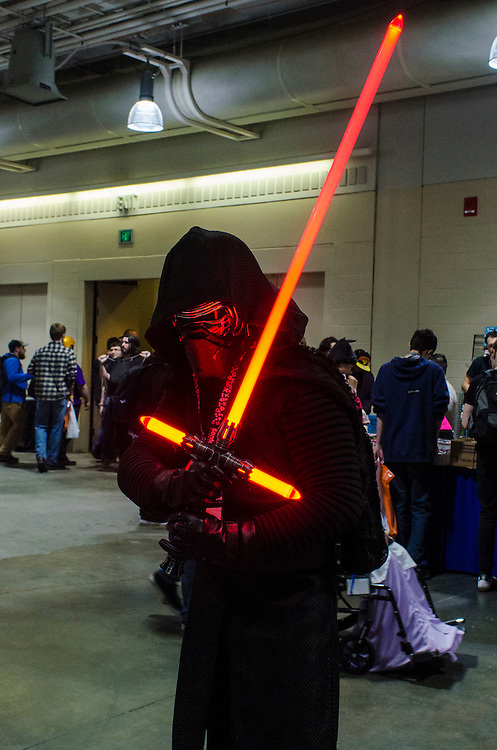 3/25/16 - Medford/Somerville, MA - A convention attendee dressed as Kylo Ren from Star Wars poses with a lightsaber at fan convention Anime Boston in the Hynes Convention Center on Friday, Mar 25, 2016. (Ray Bernoff / The Tufts Daily)