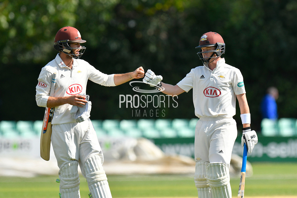 Ben Foakes of Surrey and Ollie Pope of Surrey touch gloves as they walk off for lunch during the final day of the Specsavers County Champ Div 1 match between Worcestershire County Cricket Club and Surrey County Cricket Club at New Road, Worcester, United Kingdom on 13 September 2018.