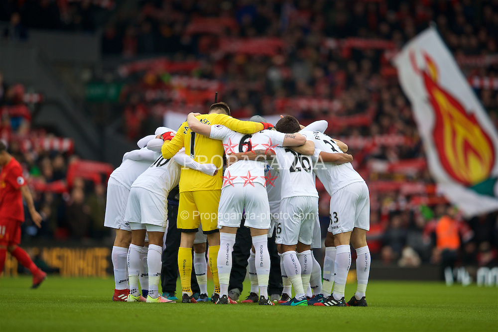 LIVERPOOL, ENGLAND - Saturday, January 21, 2017: Swansea City players form a pre-match huddle before the FA Premier League match against Liverpool at Anfield. (Pic by David Rawcliffe/Propaganda)