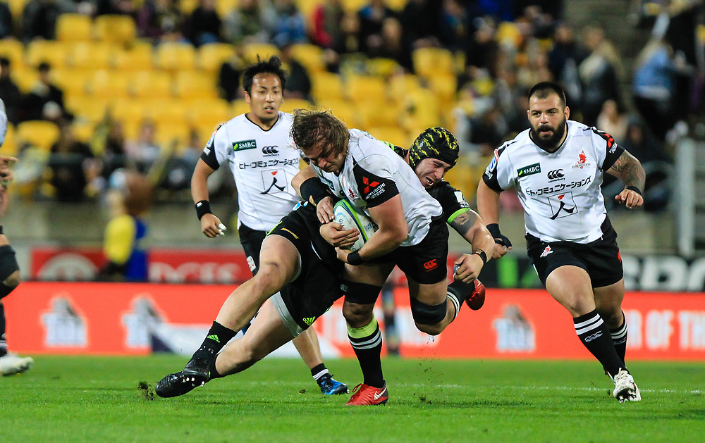 Jeff Toomaga-Allen tackles during the Super Rugby union game between Hurricanes and Sunwolves, played at Westpac Stadium, Wellington, New Zealand on 27 April 2018.   Hurricanes won 43-15.