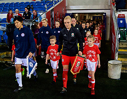 CARDIFF, WALES - Friday, November 24, 2017: Wales' captain Sophie Ingle and Kazakhstan's captain Begaim Kirgizbaeva lead their sides out before the FIFA Women's World Cup 2019 Qualifying Round Group 1 match between Wales and Kazakhstan at the Cardiff City Stadium. (Pic by David Rawcliffe/Propaganda)