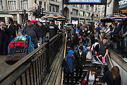 Rush hour at Oxford street where homeless and workers meet briefly.
