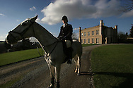 Emma Holloway prepares to ride out for a day's foxhunting from her 17th century home, Pen Y Lan House, which has been in her family's hands for over 160 years. The Wynnstay Hunt, named after Sir Watkin Williams-Wynn, dated back to the 18th century and hunted on country estates in Shropshire, Cheshire and north Wales. Hunting with dogs in England and Wales became illegal on 18th February 2005 despite legal challenges to the ban and many hunts vowed to continue the ancient sport of foxhunting, risking prosecution.