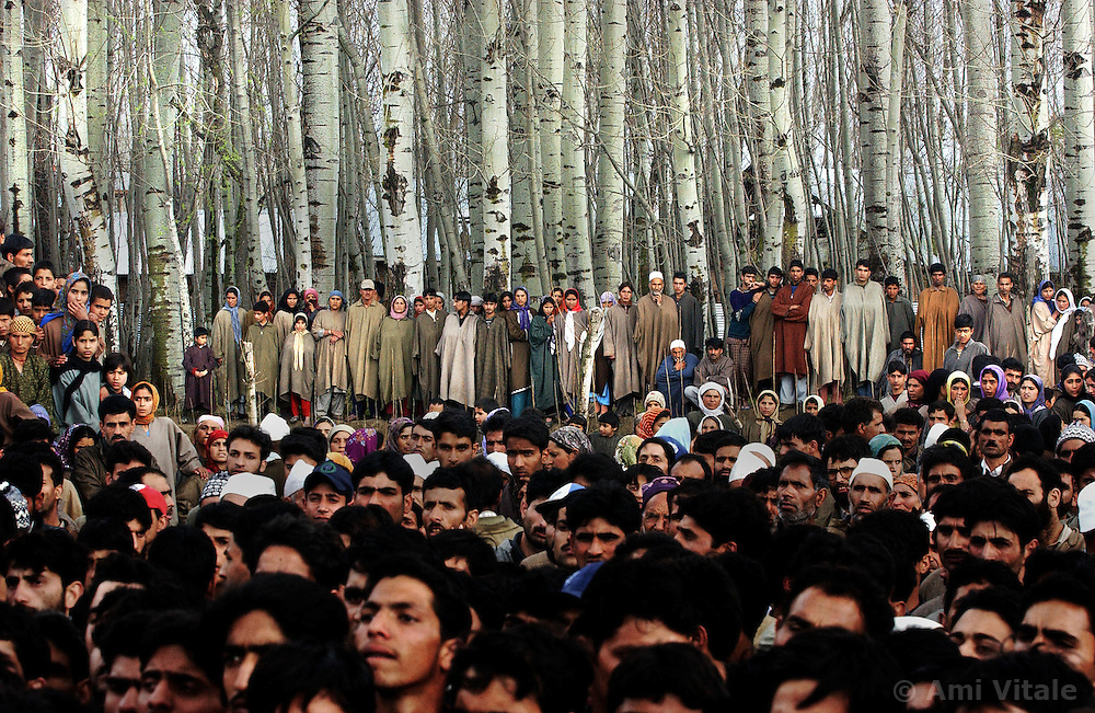 Villagers mourn the death of five people who were killed along with  48 who were injured, when a grenade exploded in the hands of a man who was seeking to extort money from a family in Badgam district of Kashmir, March 10, 2004.   Locals said the man was a former militant who was extorting money from villagers and thousands came out to mourn the deaths. Tens of thousands of people have died in Kashmir since the eruption of anti-Indian revolt in the region in 1989. Separatists put the toll at between 80,000 and 100,000.