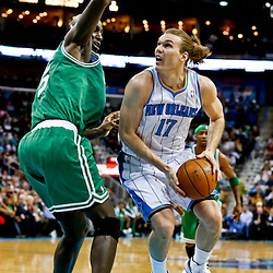 Mar 20, 2013; New Orleans, LA, USA; New Orleans Hornets power forward Lou Amundson (17) is guarded by Boston Celtics center Kevin Garnett (5) during the second quarter of a game at the New Orleans Arena. Mandatory Credit: Derick E. Hingle-USA TODAY Sports