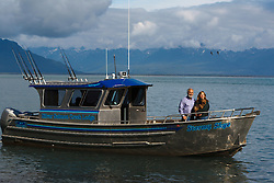 Owners of Silver Salmon Creek lodge in their boat Stormy Skye, Duck Island, Tuxedni Wilderness, Alaska Maritime National Wildlife Refuge, Alaska, United States of America