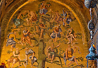 Detail of a beautiful, golden tile mosaic of figures in at tree from St Mark's Basilica, Venice, Italy.