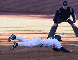 Virginia Cavaliers infielder Greg Miclat (2) beats a pick off attempt back to first base in action against Delaware.  The Virginia Cavaliers Baseball Team defeated the Delaware Blue Hens 11-2 in the first of a three game series at Davenport Field in Charlottesville, VA on March 2, 2007.