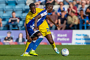 Gillingham FC forward Mikael Ndjoli  (10) and Wycombe Wanderers midfielder Nnamdi Ofoborh (28) during the EFL Sky Bet League 1 match between Gillingham and Wycombe Wanderers at the MEMS Priestfield Stadium, Gillingham, England on 14 September 2019.