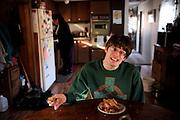 Noah Hogan, 24, of Guysville, Ohio, enjoys a snack of his mother Mary Hogan's home-made pumpkin loaf, Nov. 26, 2012.