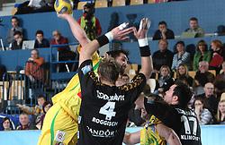 David Spiler (13) vs  Oliver Roggisch (4) and Andrej Klimovets (17) during the 1st Main round of EHL Champions League match between RK Celje Pivovarna Lasko (SLO) and Rhein Neckar Lowen (GER), on February 14, 2009, in Arena Zlatorog, Celje, Slovenia. Rhein Neckar Lowen won 34:28.  (Photo by Vid Ponikvar / Sportida)