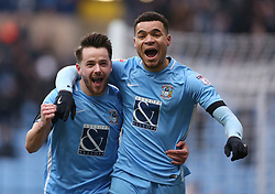 Coventry City's Max Biamou celebrates scoring the first goal against Swindon Town during the match at the Ricoh Arena with fellow goal scorer Marc McNulty