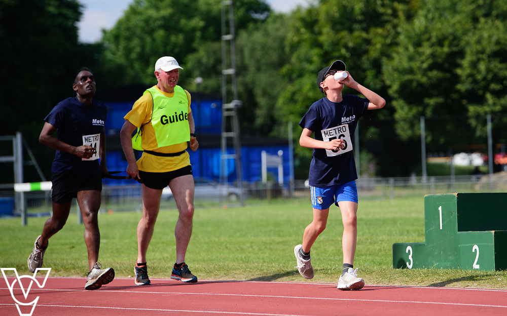 Metro Blind Sport's 2017 Athletics Open held at Mile End Stadium.  5000m.  From left, Competitor #14, with guide runner, Aaron Reynolds<br /> <br /> Picture: Chris Vaughan Photography for Metro Blind Sport<br /> Date: June 17, 2017