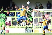 Forest Green Rovers Farrend Rawson(6) and Mansfield Town's Jordan Graham(29) during the EFL Sky Bet League 2 match between Forest Green Rovers and Mansfield Town at the New Lawn, Forest Green, United Kingdom on 19 October 2019.