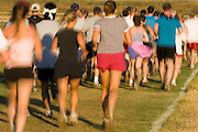 blurred action of runners during a cross country race