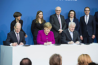 12 MAR 2018, BERLIN/GERMANY:<br /> Horst Seehofer (L), CSU, desig. Bundesinnenminister, Angela Merkel (M), CDU, Bundeskanzlerin, und Olaf Scholz (R), SPD, desig. Bundesfinanzminister, in der zweiten Reihe: zwei Damen des Protokolls, Volker Kauder, CDU, CDU/CSU Fraktionsvorsitzender, Andrea Nahles, SPD Fraktionsvorsitzende, Alexander Dobrindt, Vorsitzender der CSU Landesgruppe, Unterzeichnung des Koalitionsvertrages der CDU/CSU und SPD, Paul-Loebe-Haus, Deutscher Bundestag<br /> IMAGE: 20180312-02-016