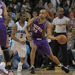 03 December 2008:  Phoenix Suns forward Grant Hill (33) guarded by New Orleans Hornets guard Chris Paul (3) passes the ball during a 104-91 victory by the New Orleans Hornets over the Phoenix Suns at the New Orleans Arena in New Orleans, LA..