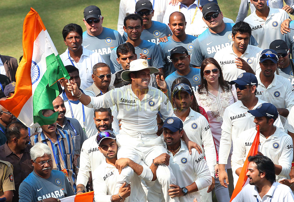 Sachin Tendulkar of India bids the fans farewell as he does a lap of the pitch after the second Star Sports test match between India and The West Indies held at The Wankhede Stadium in Mumbai, India on the 16th November 2013<br /> <br /> This test match is the 200th test match for Sachin Tendulkar and his last for India.  After a career spanning more than 24yrs Sachin is retiring from cricket and this test match is his last appearance on the field of play.<br /> <br /> <br /> Photo by: Ron Gaunt - BCCI - SPORTZPICS<br /> <br /> Use of this image is subject to the terms and conditions as outlined by the BCCI. These terms can be found by following this link:<br /> <br /> http://sportzpics.photoshelter.com/gallery/BCCI-Image-Terms/G0000ahUVIIEBQ84/C0000whs75.ajndY