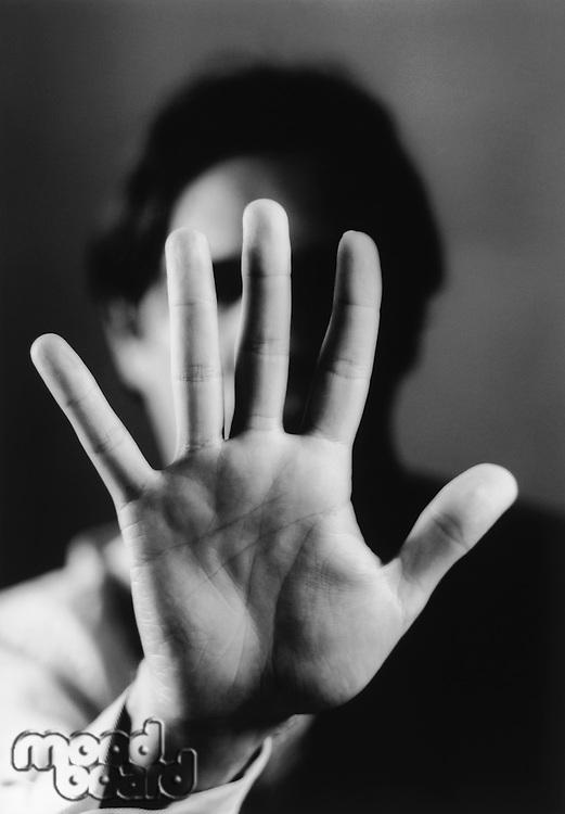 Hand Blocking Man's Face