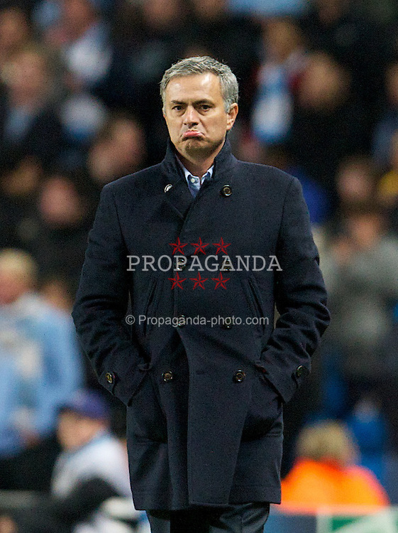 MANCHESTER, ENGLAND - Wednesday, November 21, 2012: Real Madird CF's head coach Jose Mourinho looks unhappy with the added time during the UEFA Champions League Group D match against Manchester City at the City of Manchester Stadium. (Pic by David Rawcliffe/Propaganda)