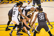 Golden State Warriors guard Klay Thompson (11) battles for a loose ball against San Antonio Spurs forward LaMarcus Aldridge (12) during Game 2 of the Western Conference Quarterfinals at Oracle Arena in Oakland, Calif., on April 16, 2018. (Stan Olszewski/Special to S.F. Examiner)