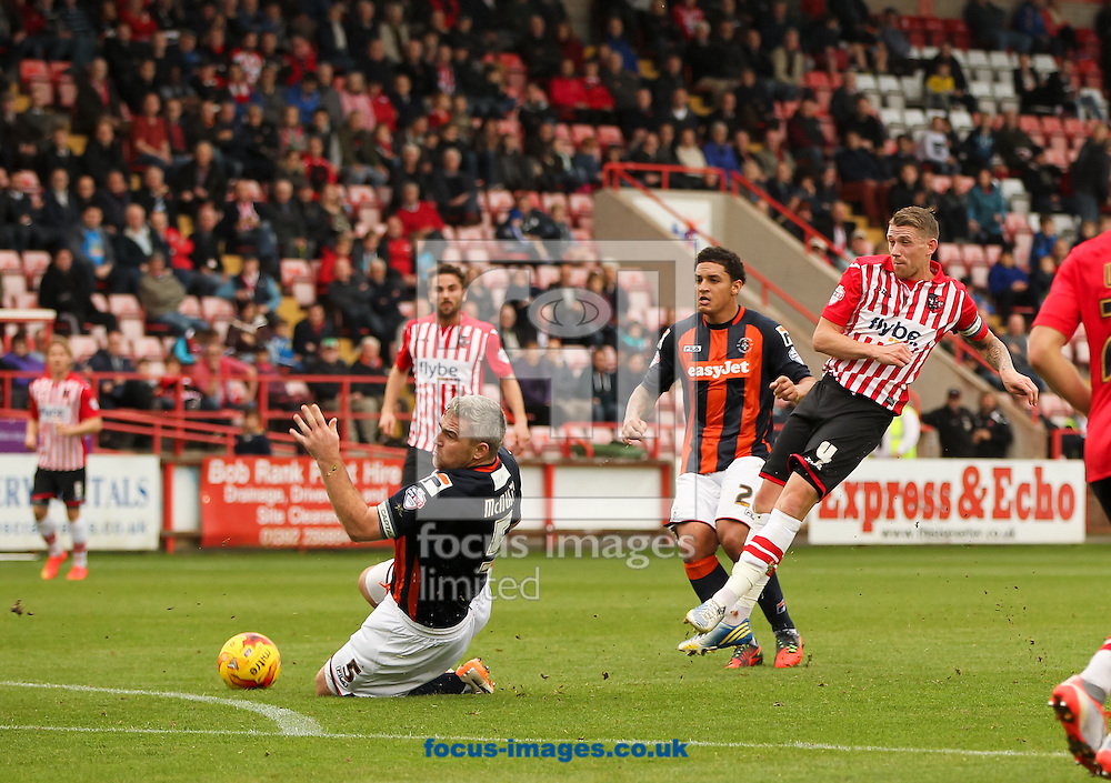 Steve McNulty (front centre left) of Luton Town block a shot from Scott Bennett (right) of Exeter City during the Sky Bet League 2 match at St James' Park, Exeter<br /> Picture by Tom Smith/Focus Images Ltd 07545141164<br /> 01/11/2014