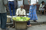 Street stall selling peeled cucumbers